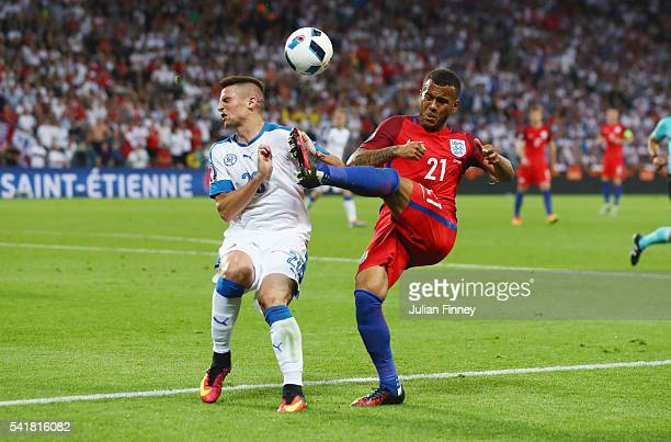 Ryan Bertrand of England clears the ball from Robert Mak of Slovakia during the UEFA EURO 2016 Group B match between Slovakia and England at Stade...