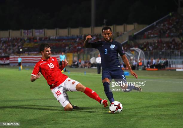 Ryan Bertrand of England is challenged by Bjorn Kristensen of Malta during the FIFA 2018 World Cup Qualifier between Malta and England at Ta'Qali...