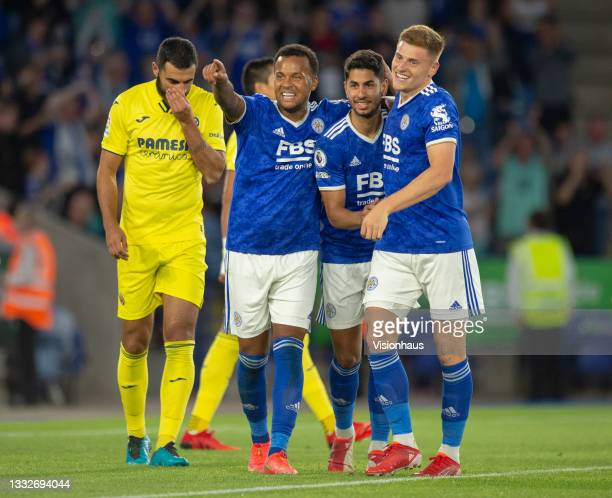 Ryan Bertrand of Leicester City celebrates with team mates Harvey Barnes and their team's second goalscorer Ayoze Pérez while Raúl Albiol of...