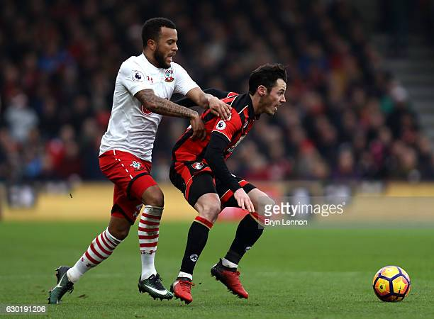 Ryan Bertrand of Southampton and Adam Smith of AFC Bournemouth battle for possession during the Premier League match between AFC Bournemouth and...