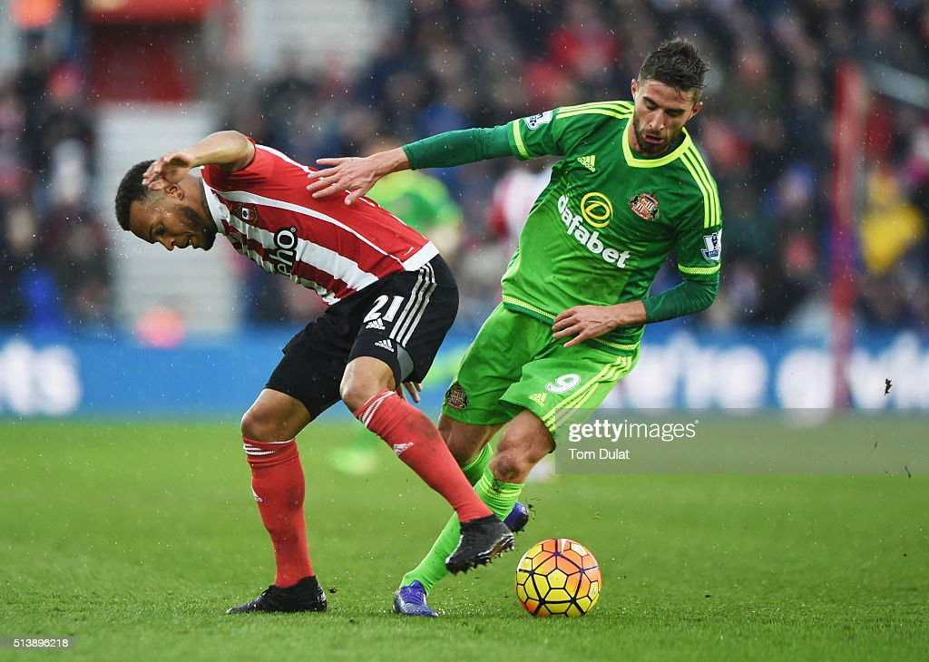 Ryan Bertrand of Southampton and Fabio Borini of Sunderland compete for the ball during the Barclays Premier League match between Southampton and Sunderland at St Mary's Stadium on March 5, 2016 in Southampton, England.