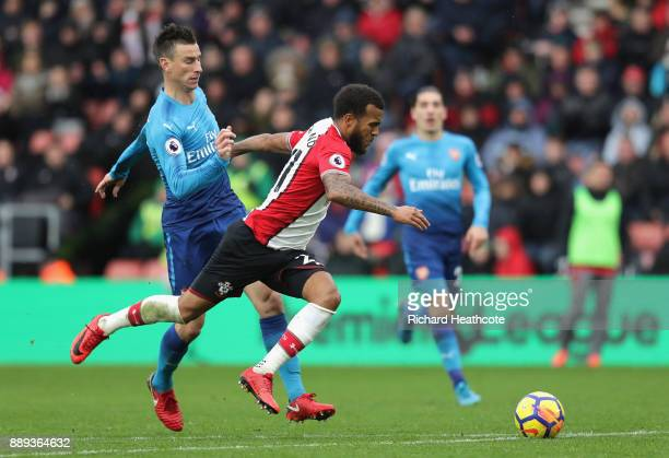 Ryan Bertrand of Southampton and Laurent Koscielny of Arsenal in action during the Premier League match between Southampton and Arsenal at St Mary's...