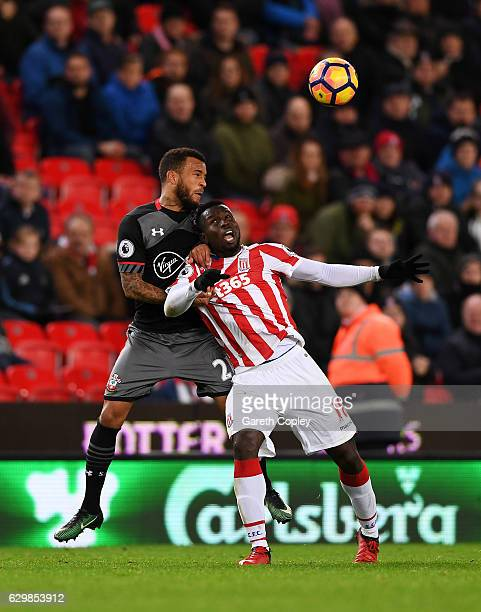 Ryan Bertrand of Southampton and Mame Biram Diouf of Stoke City battle to win a header during the Premier League match between Stoke City and...