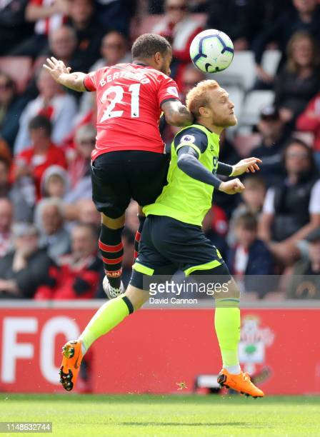 Ryan Bertrand of Southampton battles for possession with Alex Pritchard of Huddersfield Town during the Premier League match between Southampton FC...