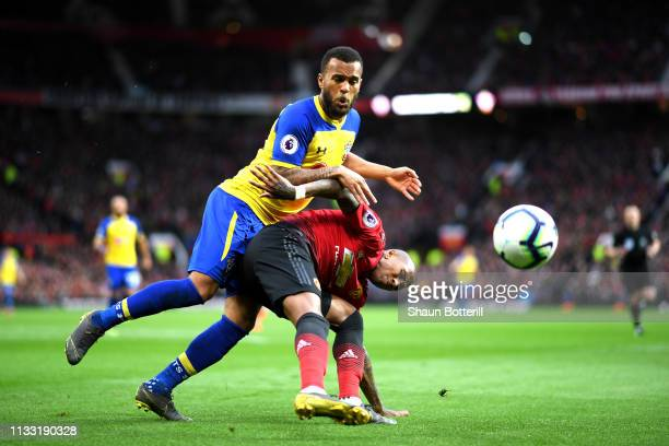 Ryan Bertrand of Southampton battles for possession with Ashley Young of Manchester United during the Premier League match between Manchester United...