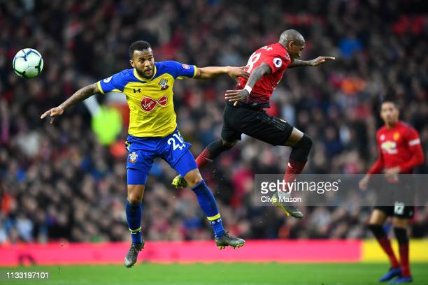 Ryan Bertrand of Southampton battles for possession with Ashley Young of Manchester United in the air during the Premier League match between...