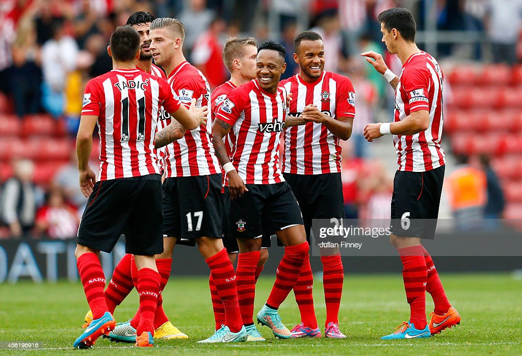 Ryan Bertrand (2nd R) of Southampton celebrates their victory with his team-mates during the Barclays Premier League match between Southampton and Queens Park Rangers at St Mary's Stadium on September 27, 2014 in Southampton, England.