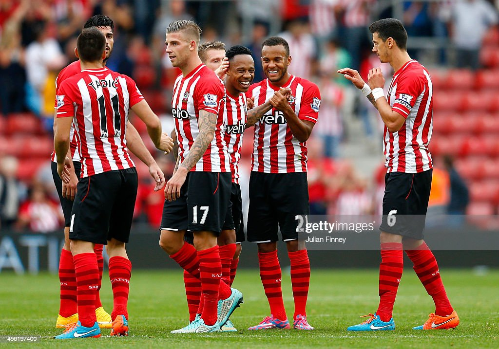 Ryan Bertrand (2nd R) of Southampton celebrates their victory with Nathaniel Clyne (C) and their team-mates during the Barclays Premier League match between Southampton and Queens Park Rangers at St Mary's Stadium on September 27, 2014 in Southampton, England.