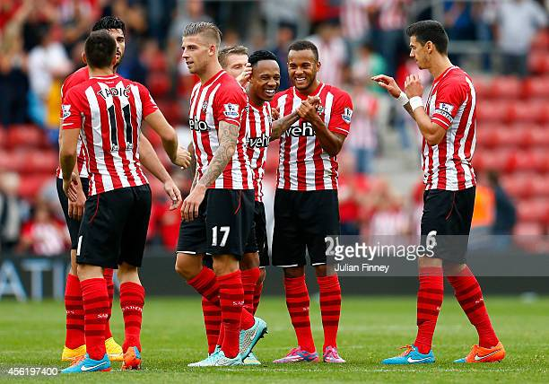 Ryan Bertrand of Southampton celebrates their victory with Nathaniel Clyne and their teammates during the Barclays Premier League match between...