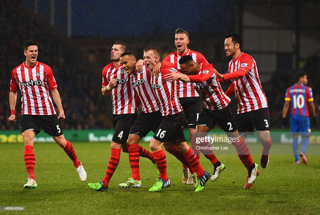 Ryan Bertrand of Southampton (3L) celebrates with team mates as he scores their second goal during the Barclays Premier League match between Crystal Palace and Southampton at Selhurst Park on December 26, 2014 in London, England.