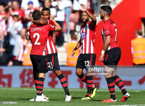 Ryan Bertrand of Southampton celebrates with teammates after scoring his sides first goal during the Premier League match between Southampton FC and...