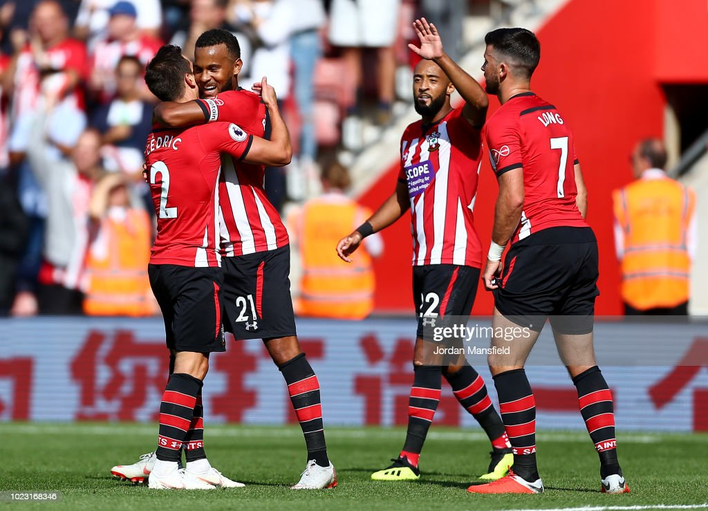 Ryan Bertrand of Southampton celebrates with teammates after scoring his sides first goal during the Premier League match between Southampton FC and Leicester City at St Mary's Stadium on August 25, 2018 in Southampton, United Kingdom.