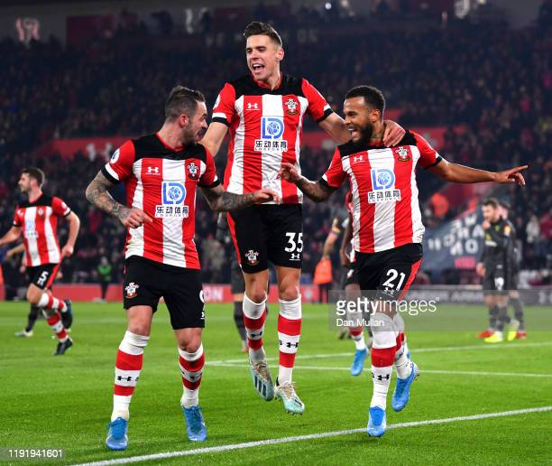 Ryan Bertrand of Southampton celebrates with teammates Jan Bednarek and Danny Ings after scoring his team's second goal during the Premier League...