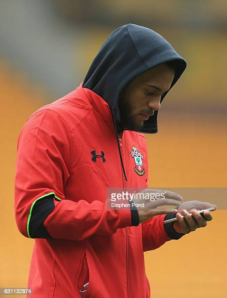 Ryan Bertrand of Southampton checks his phone during the Emirates FA Cup Third Round match between Norwich City and Southampton at Carrow Road on...