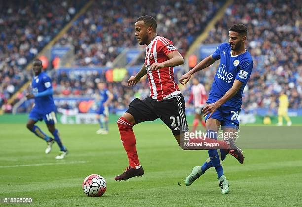 Ryan Bertrand of Southampton evades Riyad Mahrez of Leicester City during the Barclays Premier League match between Leicester City and Southampton at...