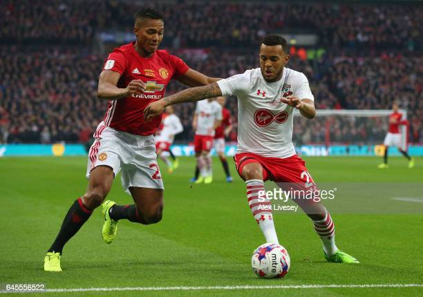 Ryan Bertrand of Southampton holds off Antonio Valencia of Manchester United during the EFL Cup Final match between Manchester United and Southampton...