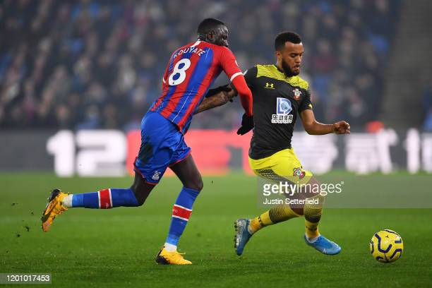 Ryan Bertrand of Southampton is tackled by Cheikhou Kouyate of Crystal Palace during the Premier League match between Crystal Palace and Southampton...