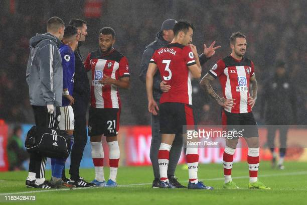 Ryan Bertrand of Southampton speaks with the fourth official Andy Madley after being sent off as Ralph Hasenhuttl, Manager of Southampton speaks to...