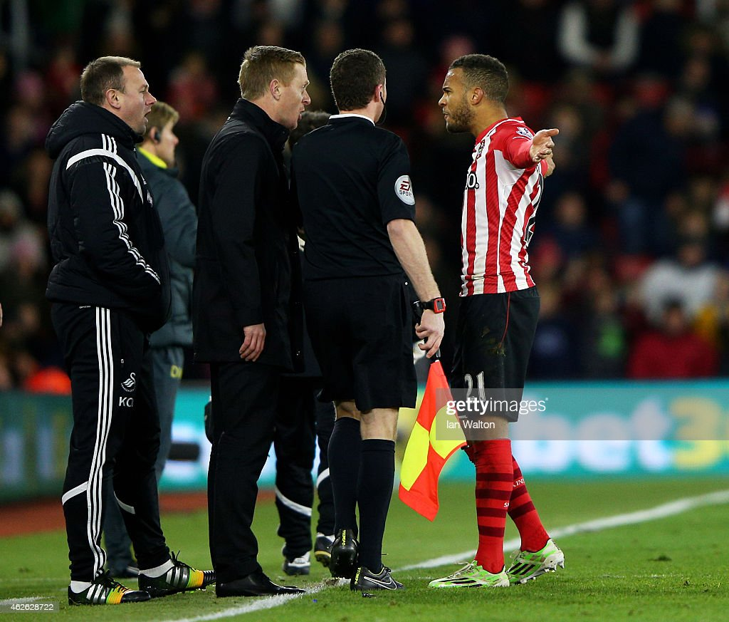Ryan Bertrand of Southampton squares up to Garry Monk the manager of Swansea City prior to receiving a straight red card for a tackle on Modou Barrow of Swansea during the Barclays Premier League match between Southampton and Swansea City at St Mary's Stadium on February 1, 2015 in Southampton, England.