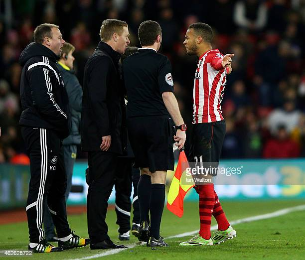 Ryan Bertrand of Southampton squares up to Garry Monk the manager of Swansea City prior to receiving a straight red card for a tackle on Modou Barrow...