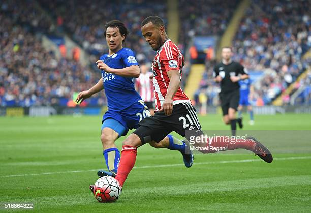 Ryan Bertrand of Southampton takes on Shinji Okazaki of Leicester City during the Barclays Premier League match between Leicester City and...