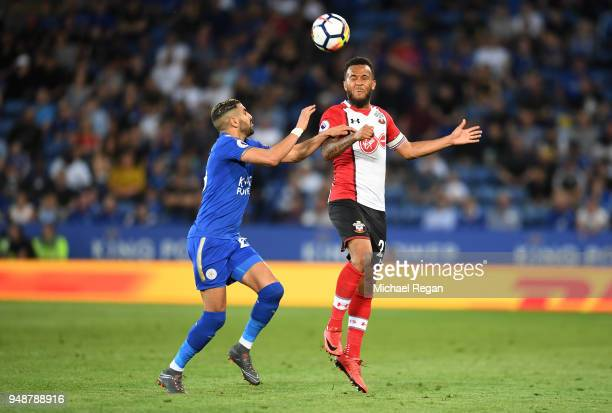 Ryan Bertrand of Southampton wins a header over Riyad Mahrez of Leicester City during the Premier League match between Leicester City and Southampton...