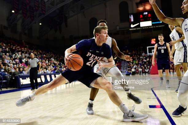 Ryan Betley of the Pennsylvania Quakers drives to the basket against Trey Phills of the Yale Bulldogs during the first half at The Palestra on...