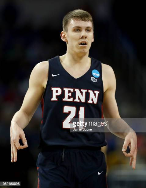 Ryan Betley of the Pennsylvania Quakers reacts after making a three point shot in the first half against the Kansas Jayhawks during the first round...