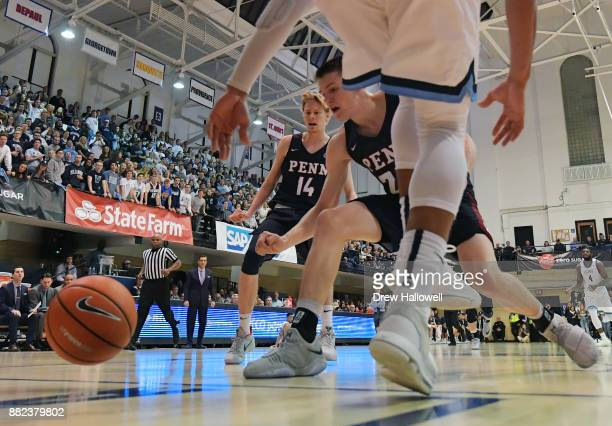 Ryan Betley of the Pennsylvania Quakers scrambles for a loose ball as Sam Jones looks on at Jake Nevin Field House on November 29 2017 in Villanova...