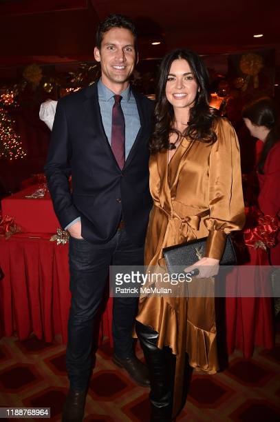 Ryan Biegel and Katie Lee attend Anne Hearst McInerney, Jay McInerney and George Farias Host Christmas Cheer at Doubles Club on December 13, 2019 in...