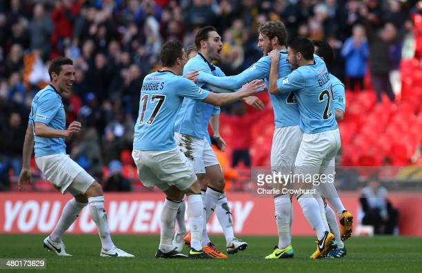 Ryan Bird of Cambridge celebrates with his team mates after scoring the first goal of the game during the The FA Carlsberg Trophy Final 2014 match...