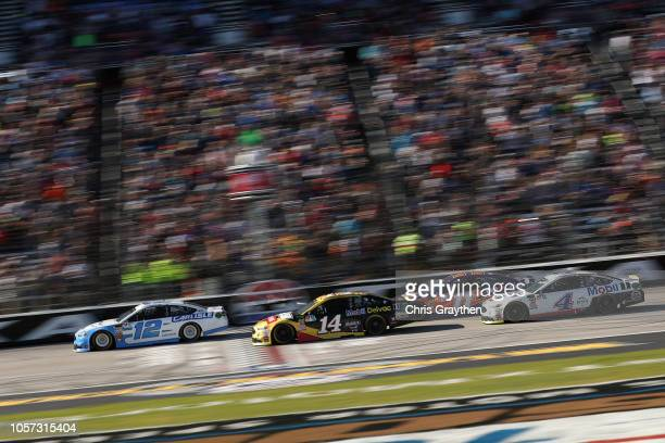 Ryan Blaney driver of the Accella/Carlisle Ford leads the field at the start of the Monster Energy NASCAR Cup Series AAA Texas 500 at Texas Motor...
