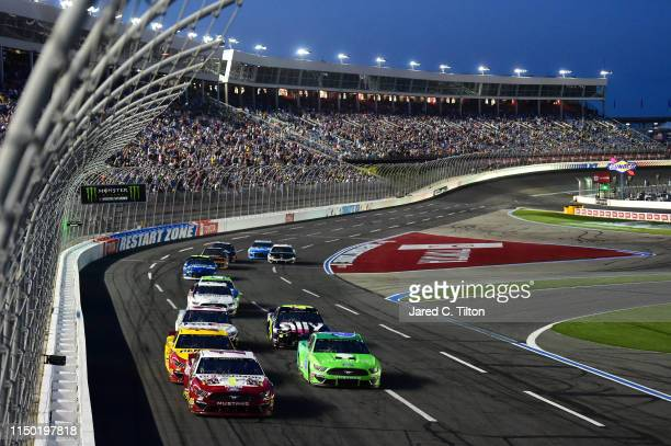 Ryan Blaney driver of the BodyArmor Ford and Ryan Newman driver of the Acorns Ford lead a pack of cars during the Monster Energy NASCAR Cup Series...