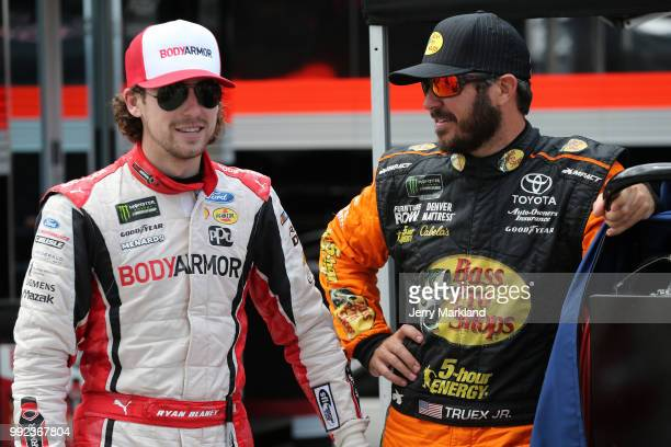 Ryan Blaney driver of the BodyArmor Ford talks with Martin Truex Jr driver of the Bass Pro Shops/5hour ENERGY Toyota during practice for the Monster...