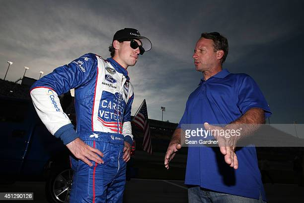Ryan Blaney driver of the Cooper Standard Careers for Vets Ford talks with his dad Dave Blaney during the NASCAR Camping World Series UNOH 225 at...