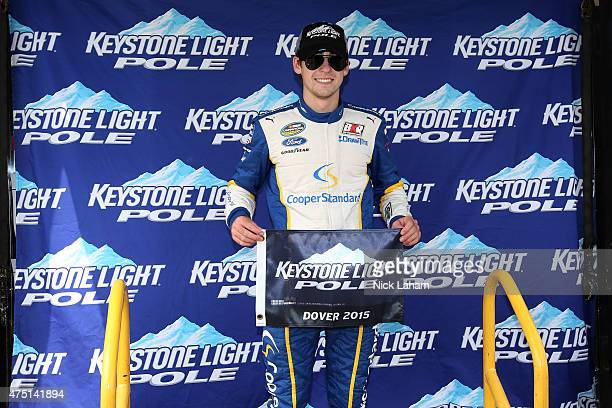 Ryan Blaney driver of the Cooper Standard Ford poses with the Keystone Light Pole Award after qualifying for pole position for the NASCAR Camping...
