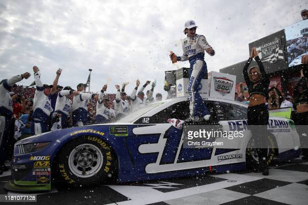 Ryan Blaney driver of the Dent Wizard Ford celebrates in Victory Lane after winning the Monster Energy NASCAR Cup Series 1000Bulbscom 500 at...