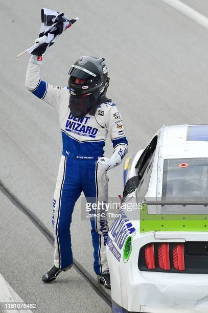 Ryan Blaney driver of the Dent Wizard Ford celebrates winning the Monster Energy NASCAR Cup Series 1000Bulbscom 500 at Talladega Superspeedway on...