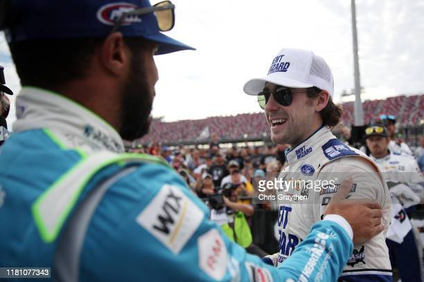 Ryan Blaney driver of the Dent Wizard Ford is congratulated after winning by Bubba Wallace driver of the Victory Junction Chevrolet during the...