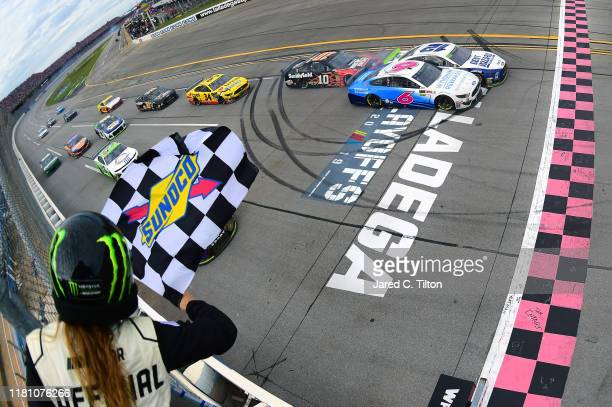 Ryan Blaney driver of the Dent Wizard Ford takes the checkered flag ahead of Ryan Newman driver of the Wyndham Rewards Ford to win the Monster Energy...