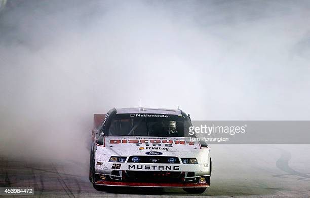 Ryan Blaney driver of the Discount Tire Ford celebrates with a burnout after winning the NASCAR Nationwide Series Food City 300 at Bristol Motor...