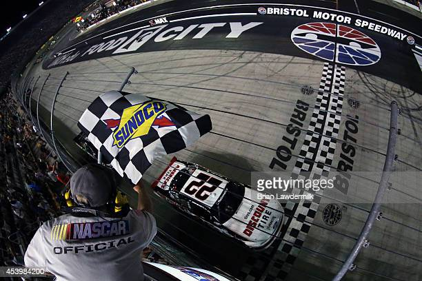 Ryan Blaney driver of the Discount Tire Ford takes the checkered flag to win the NASCAR Nationwide Series Food City 300 at Bristol Motor Speedway on...