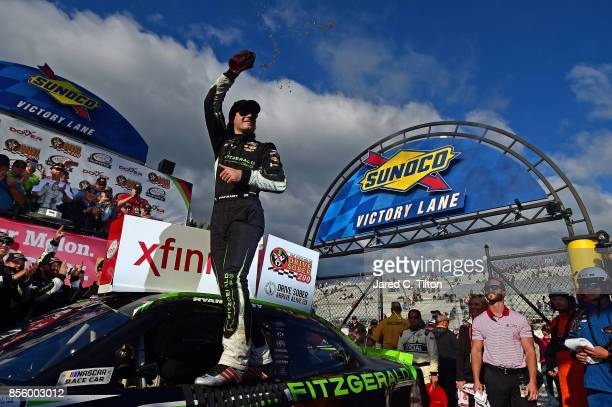 Ryan Blaney driver of the Fitzgerald Ford celebrates in Victory Lane after winning the NASCAR XFINITY Series 'Use Your Melon Drive Sober 200' at...