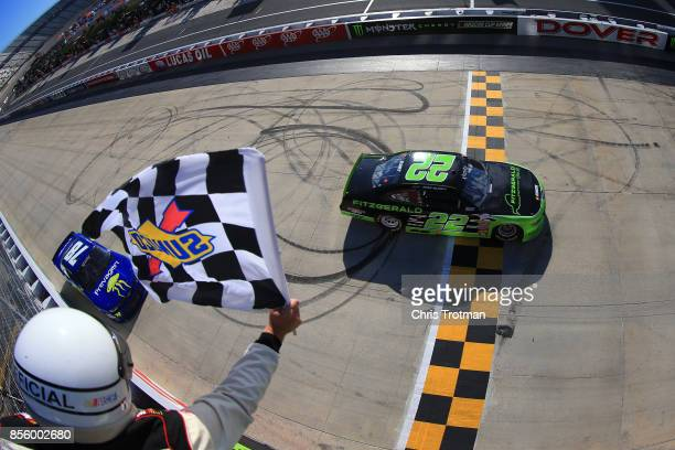 Ryan Blaney driver of the Fitzgerald Ford crosses the finish line to win the NASCAR XFINITY Series 'Use Your Melon Drive Sober 200' at Dover...
