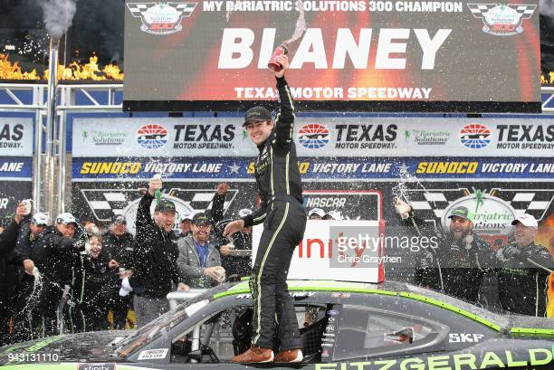 Ryan Blaney driver of the Fitzgerald Glider Kits Ford celebrates in Victory Lane after winning the NASCAR Xfinity Series My Bariatric Solutions 300...