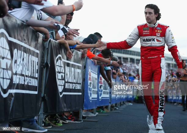 Ryan Blaney driver of the Hawk/Carlisle Ford participates in prerace ceremonies prior to the Monster Energy NASCAR Cup Series AllStar Race at...