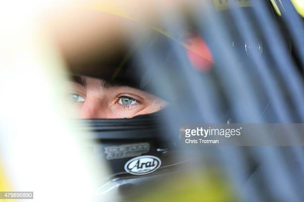 Ryan Blaney driver of the Hertz Ford sits in his car during practice for the NASCAR XFINITY Series Buckle Up 200 presented by Click It Or Ticket at...