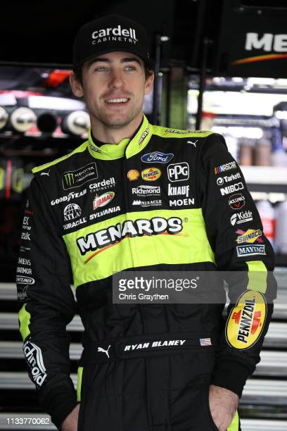 Ryan Blaney driver of the Menards/Cardell Cabinetry Ford stands in the garage area during practice for the Monster Energy NASCAR Cup Series O'Reilly...