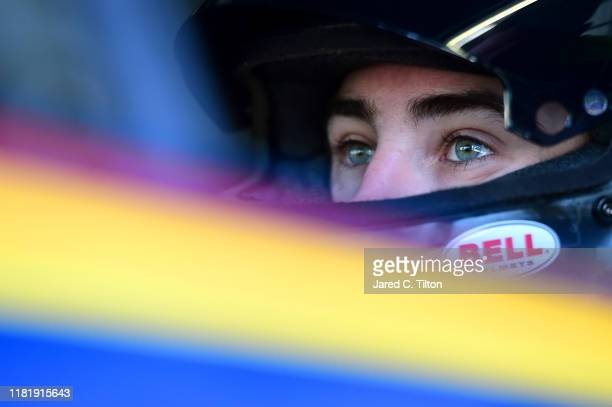 Ryan Blaney driver of the Menards/Dickies Ford sits in his car during practice for the Monster Energy NASCAR Cup Series Hollywood Casino 400 at...