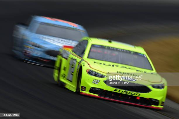 Ryan Blaney driver of the Menards/Duracell Ford leads Kevin Harvick driver of the Busch Beer Ford during the Monster Energy NASCAR Cup Series Pocono...